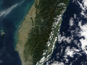 Taiwan is mostly mountainous in the east, but gradually transitions to gently sloping plains in the west (satellite photo by NASA).