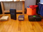 English: Video game consoles of the sixth generation (from left to right, Dreamcast, PlayStation 2, Nintendo GameCube, Xbox).