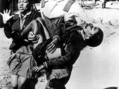 Antoinette Sithole and Mbuyisa Makhubo carrying and 12-year-old Hector Pieterson moments after he was shot by South African police during a peaceful student demonstration in Soweto, South Africa