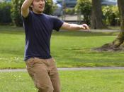 A Frisbee player catches the frisbee.