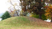 English: Burial mound at the University of Tennessee's College of Agriculture campus in Knoxville, Tennessee, USA. This mound was constructed by the area's Late Woodland period inhabitants circa 1000 A.D.