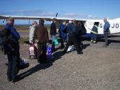 English: Baggage handling at Foula airstrip. Islanders' shopping from Lerwick is being offloaded whilst day visitors wait to load their bags for the return trip.