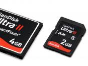 English: A comparison of three different size memory cards. Left to right: compact flash, SD card and micro SD.