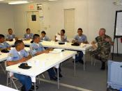 US Navy 070822-N-4939D-029 A Sailor assigned to Expeditionary Training Command discusses different leadership styles with Honduran sailors during Leadership and Professional Development training
