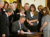 United States President George W. Bush signs the Unborn Victims of Violence Act of 2004
