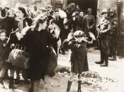 Warsaw Jews being held at gunpoint by SS troops. Warsaw Ghetto Uprising, April 1943.