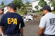 English: Pago Pago, AS, October 2, 2009 -- Chris Reiner, U.S. Environmental Protection Agency and a representative from American Samoa Environmental Protection Agency observe a hazardous waste collection center. The containment of hazardous waste is an im