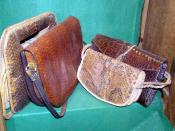 Crocodile skin handbags in a conservation exhibit at Bristol Zoo, England