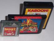 Standard game cartridges for several popular consoles. From front to back: Game Boy Color, Sega Genesis, and Atari 2600.