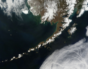 Satellite picture of the Aleutian Islands and the Alaska Peninsula, located in the south of the state of Alaska, United States.