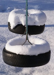 English: Snow on a black tire swing. Location: My garden in the vicinity of Viborg, Denmark. Rotated and cropped using GIMP.