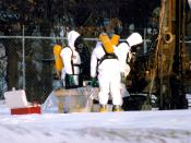 Workers in hazmat suits check the status of a cleanup site