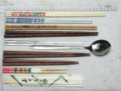 From top to bottom: Plastic chopsticks from Taiwan, porcelain chopsticks from mainland China, bamboo chopsticks from Tibet, palmwood chopsticks from Indonesia (Vietnamese style), stainless flat chopsticks from Korea (plus a matching spoon), a Japanese cou