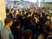 Shi'a Muslims in Bahrain strike their chests during the Remembrance of Muharram.