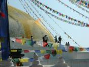 Saffron scented water is tossed on the Boudha Stupa to form the lotus petals, prayer flags, Boudha, Kathmandu, Nepal
