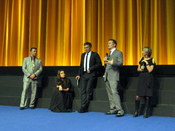 English: Black Swan cast and crew (from left to right: producer Scott Franklin, actress Mila Kunis, actor Vincent Cassel, director Darren Aronofsky) discuss the film with a moderator at the BFI London Film Festival, where the movie was nominated for Best