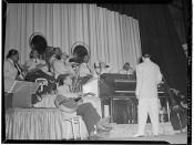 [Portrait of Duke Ellington, Junior Raglin, Juan Tizol, Barney Bigard, Ben Webster, Harry Carney, Rex William Stewart, and Sonny Greer, Howard Theater(?), Washington, D.C., between 1938 and 1948] (LOC)
