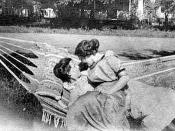 English: Vintage photograph of two intimate women in a hammock, circa 1900.