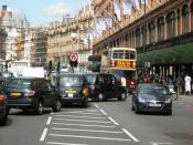 Traffic congestion on the Brompton Road outside Harrods (part of the A4). This road is part of the extended congestion charge zone.