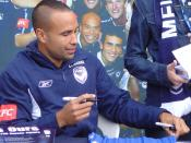 Archie Thompson signing an autograph at the Melbourne Victory Family Day, Melbourne Docklands. asianfc.com