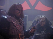 Michael Dorn and Robert O'Reilly as Worf and Gowron in an episode of Star Trek: The Next Generation, sporting Fletcher's costumes. Worf holds a knife known as a d'k tahg; Polak, Steven (1998-10-13).