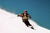 Skier carving a turn off piste