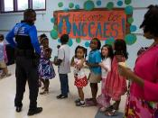 North Charleston Police Officer Daniel Stewart visiting with students