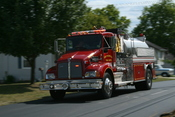 English: A truck of the Swepsonville volunteer fire department rushing north on East Main Street in Swepsonville, North Carolina.