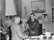 English: Original Caption: Photograph of President Truman in the Oval Office, evidently receiving a Menorah as a gift from the Prime Minister of Israel, David Ben-Gurion (center), and Abba Eban, the Ambassador of Israel to the United States.: 05/08/1951 U