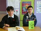 Students from Kabul, Afghanistan in the UK with Dari textbooks published by USAID.