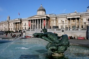 Fountain in Trafalgar Square, with the National Gallery in the background.