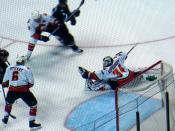Finnish ice-hockey goalder Miikka Kiprusoff make a save in game versus San Jose Sharks