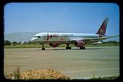 English: Airplane belonging to Tajik Air sitting on an airfield, presumably Dushanbe Airport.