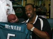 Philadelphia Eagles quarterback Donovan McNabb signed a football jersey belonging to Storekeeper 2nd Class of Fleet Industrial Supply Center, Pearl Harbor. McNabb visited the Silver Dolphin Bistro at Naval Station Pearl Harbor on Feb. 3 to meet with Sailo