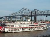 The paddleboat Natchez, on the Mississippi River from the East Bank of New Orleans, with the Crescent City Connection Bridges.