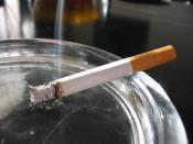 a lit cigarette in an ashtray