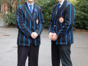 Two Dulwich College Upper School boys display uniforms