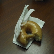 English: Here is a half eaten donut from dunkin donuts