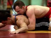 Even on the mat, a Greco-Roman wrestler must still find ways to turn his opponent's shoulders to the mat for a fall without using the legs.