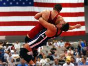 Two U.S. Air Force members wrestling in a Greco-Roman match.