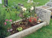 The grave of J. R. R. and Edith Tolkien, Wolvercote Cemetery, Oxford.
