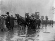 English: People and horses draped in black walk in procession in memory of the victims of the Triangle Shirtwaist Company fire, New York City.
