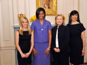 English: U.S. Secretary of State Hillary Rodham Clinton stands with Avon's Global Ambassador Reese Witherspoon, First Lady Michelle Obama, and Avon's Chairwoman and CEO Andrea Jung at the 2010 International Women of Courage Awards at the U.S. Department o