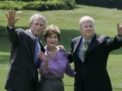 President George W. Bush stands with Mrs. Laura Bush and Deputy Chief of Staff Karl Rove on the South Lawn Monday, August 13, 2007, shortly after his longtime friend and senior advisor announced his resignation.