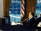 English: President Gerald R. Ford watches ASTP crewmen Thomas P. Stafford, Donald K. Slayton and Valeriy N. Kubasov on television as he talks to them via radio-telephone while they orbited the Earth on July 18, 1975. The American Apollo spacecraft and Sov