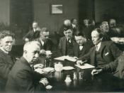 English: Six of the Group of Seven, plus their friend Barker Fairley, in 1920. From left to right: Frederick Varley, A. Y. Jackson, Lawren Harris, Fairley, Frank Johnston, Arthur Lismer, and J. E. H. MacDonald. It was taken at The Arts and Letters Club of