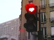 A real traffic light with a red heart.