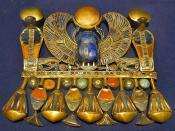 English: Winged scarab of Tutankhamun with semi-precious stones. This pectoral is composed of Tut's Prenomen name: