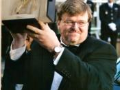 English: Michael Moore receiving the Palme d'or at the Cannes film festival, for