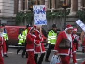 Protest march by supporters of Fathers for Justice, dressed as Father Christmas to